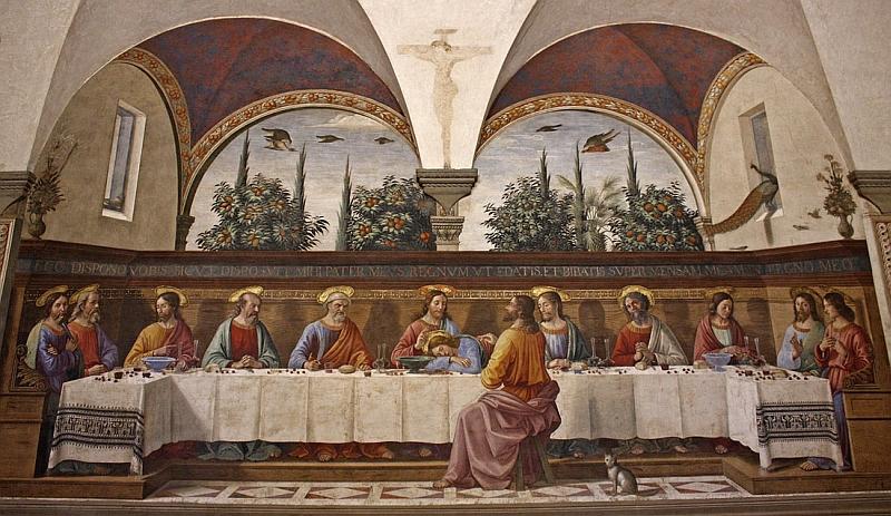 Santa Ceia. Detalhe para Judas o traidor, sentado sozinho do outro lado da mesa junto de um gato.